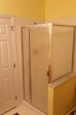 before updating the shower door