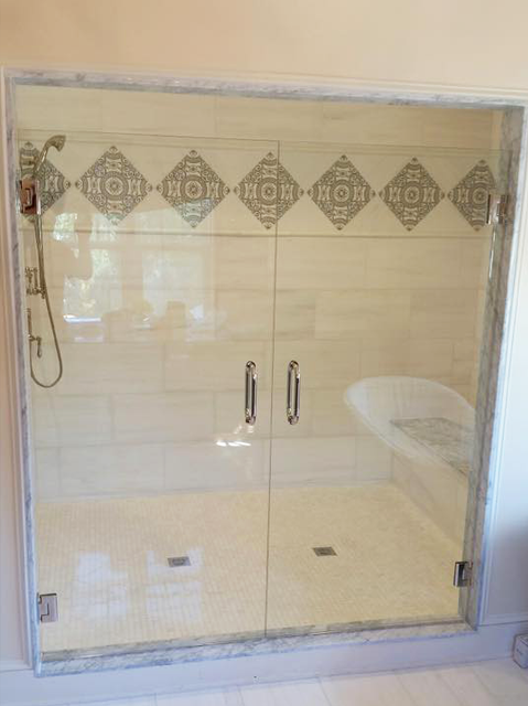Double door shower enclosure