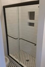 Black and White Shower with glass door by Bryn Mawr Glass