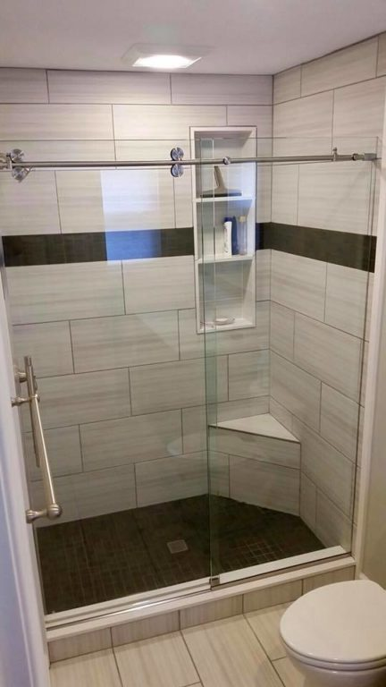 frameless glass shower door with silver handle